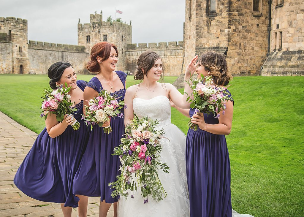 bride and bridesmaids at alnwick castle