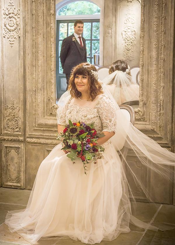 bride sitting groom mirror