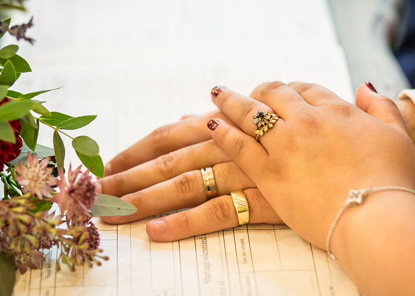 hands on register with rings