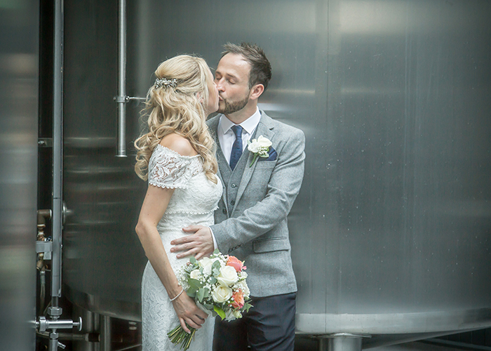 happy couple by beer vats