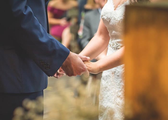 wedding service holding hands