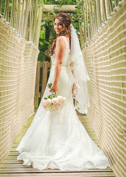 alnwick treehouse wedding photo of bride on rope bridge