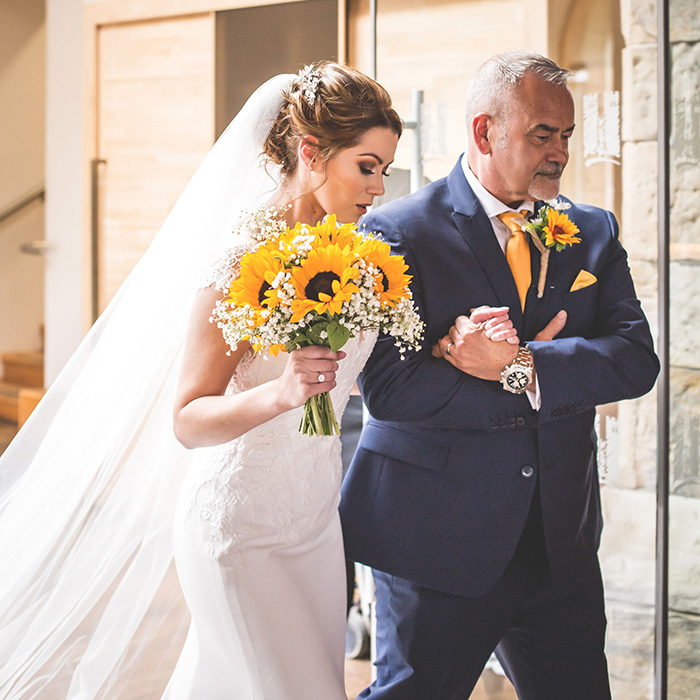 bride arriving with her father