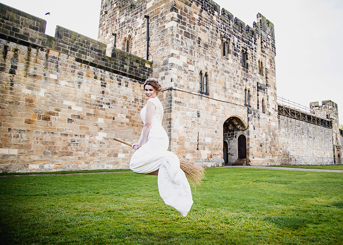 bride flying broomstick at alnwick castle