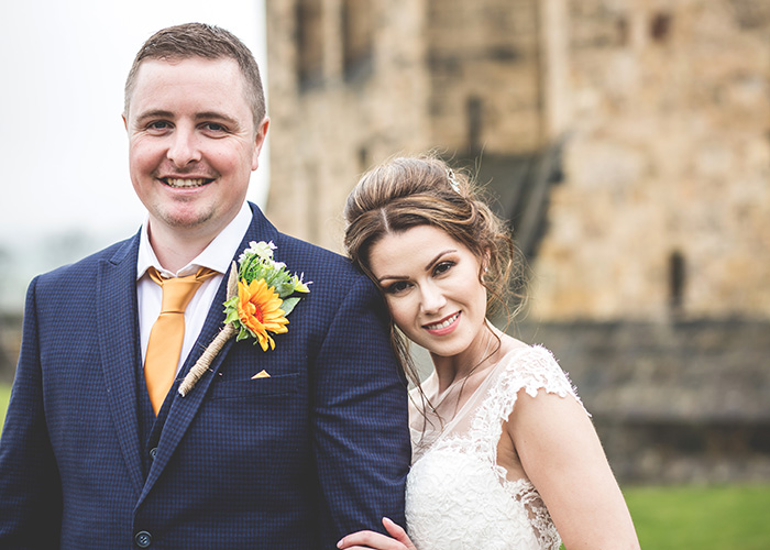 bride head on grooms shoulder