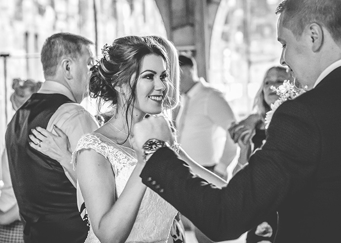 brid and groom dancing with guests