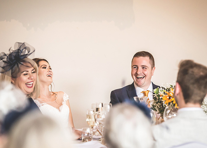 family laughing at father of the brides speech