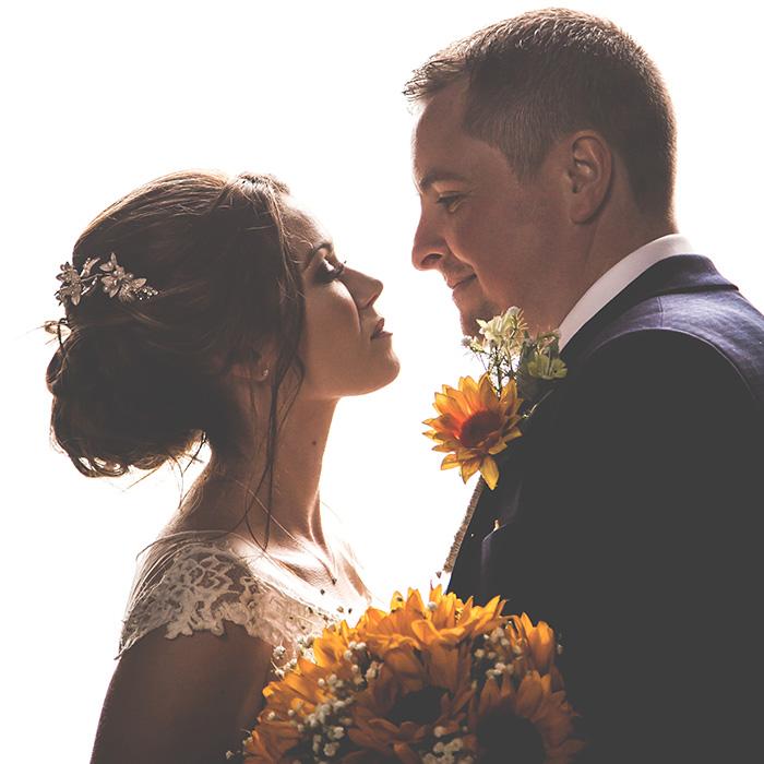 large square photo of wedding couple