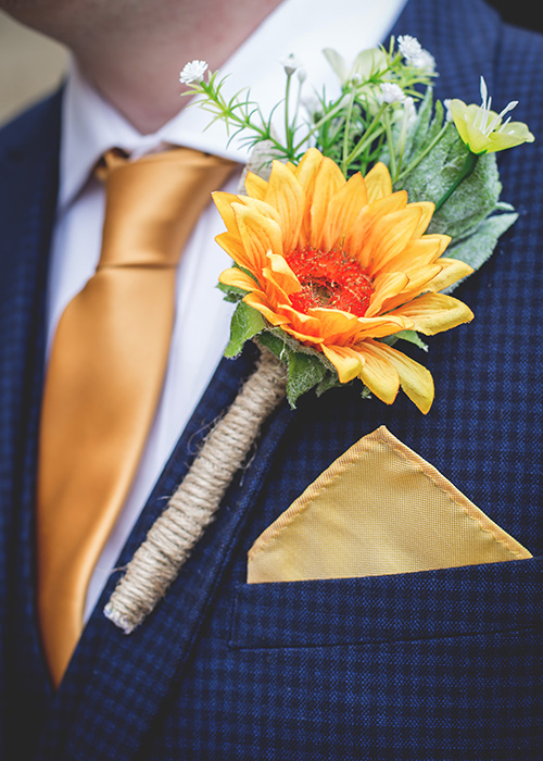 sunflower buttonhole yellow with blue suit