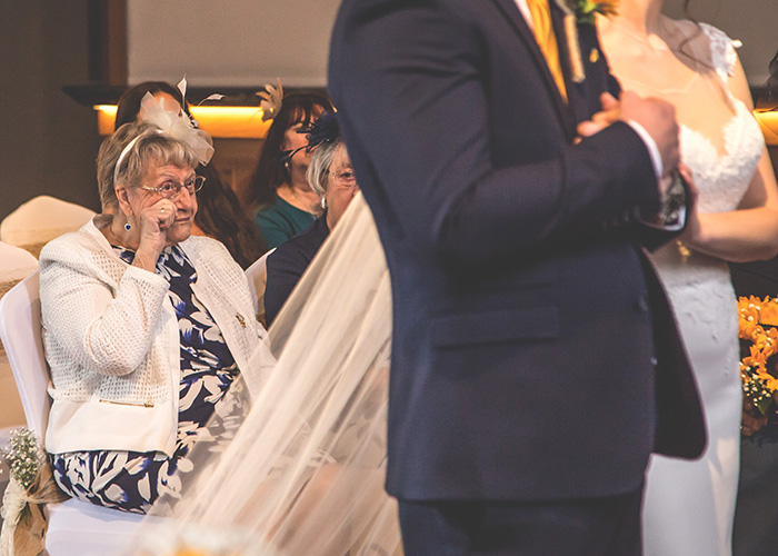tearful guest at wedding ceremony