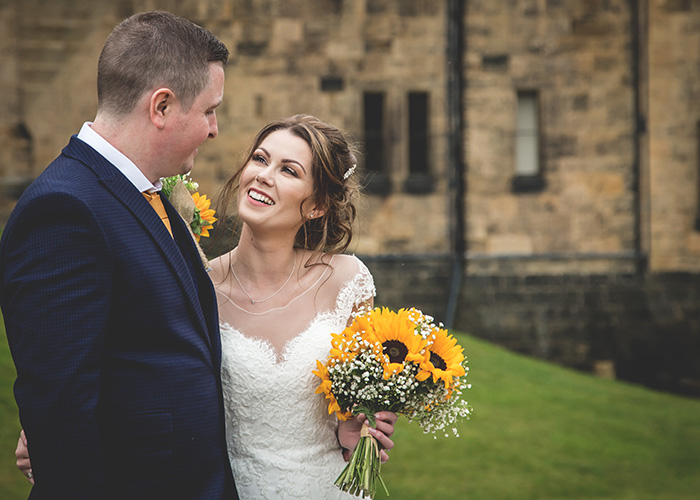happy couple with sunflower bouquet