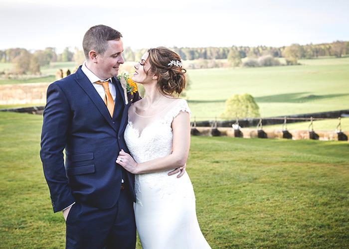bride groom overlooking alnwick pastures